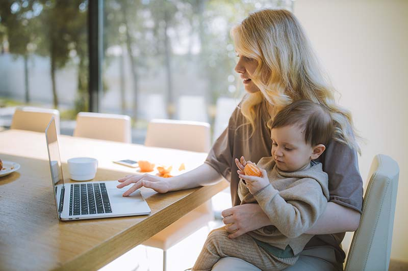 mom with child and computer
